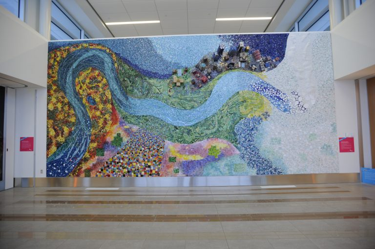 Everything Flows, Nothing Stands Still Artwork; This mixed media art spans 30 feet with thousands of mosaic tesserae (tiles) in vivid hues representing transitions in time and place.
