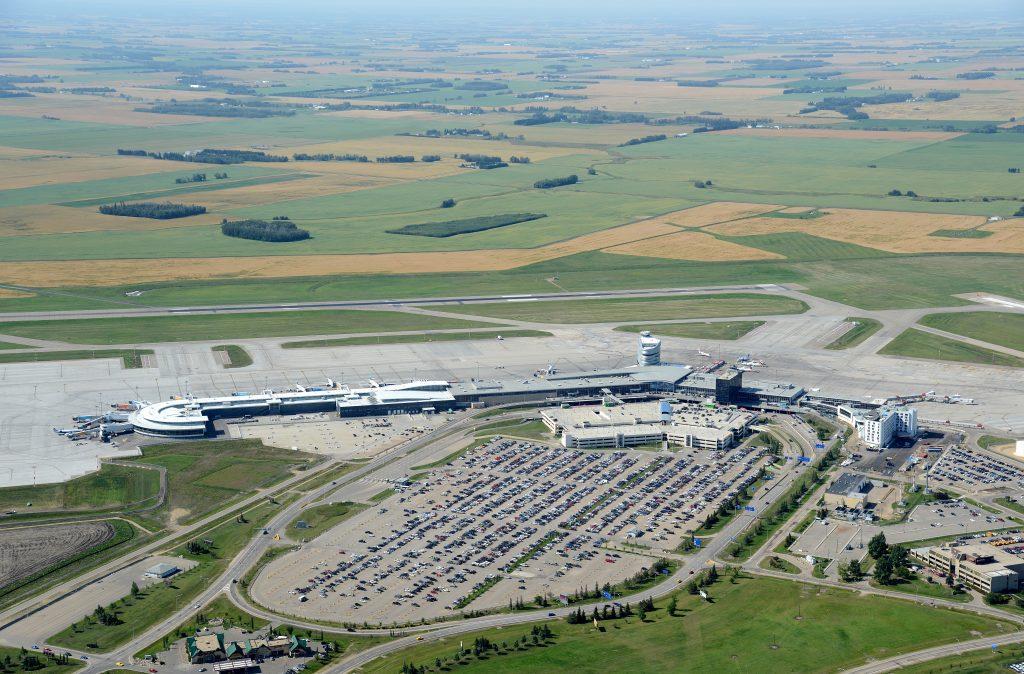Airport Terminal and Runway Birds Eye View Facing South