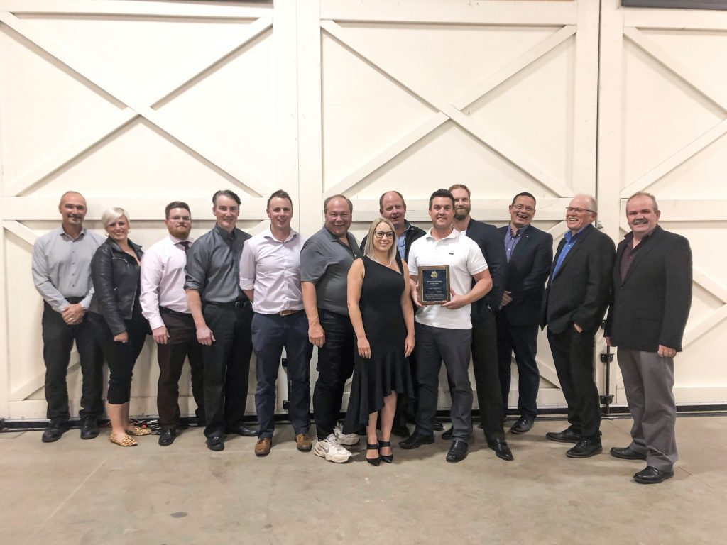 Members of EIA's Maintenance Section pose with the PEMAC Award