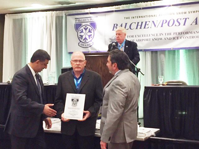 Photograph of Board Members accepting the Balchen/Post award of excellence