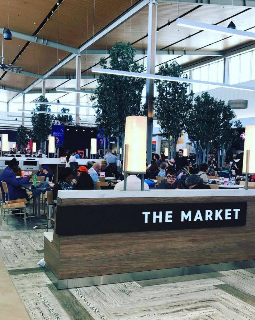Customers enjoying The Market food court at Premium Outlet Collection - Edmonton International Airport