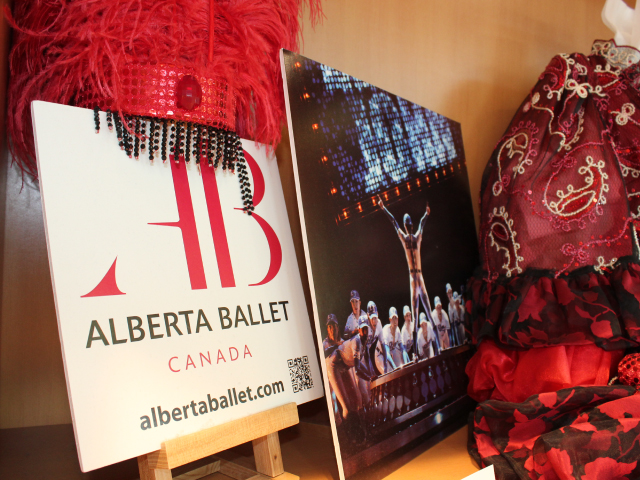 Photo of costumes, signs and photos from Alberta Ballet