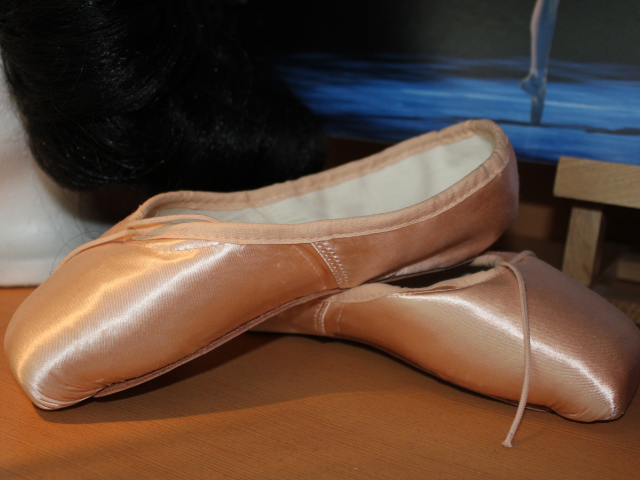 Slippers used by a performer in the Alberta Ballet