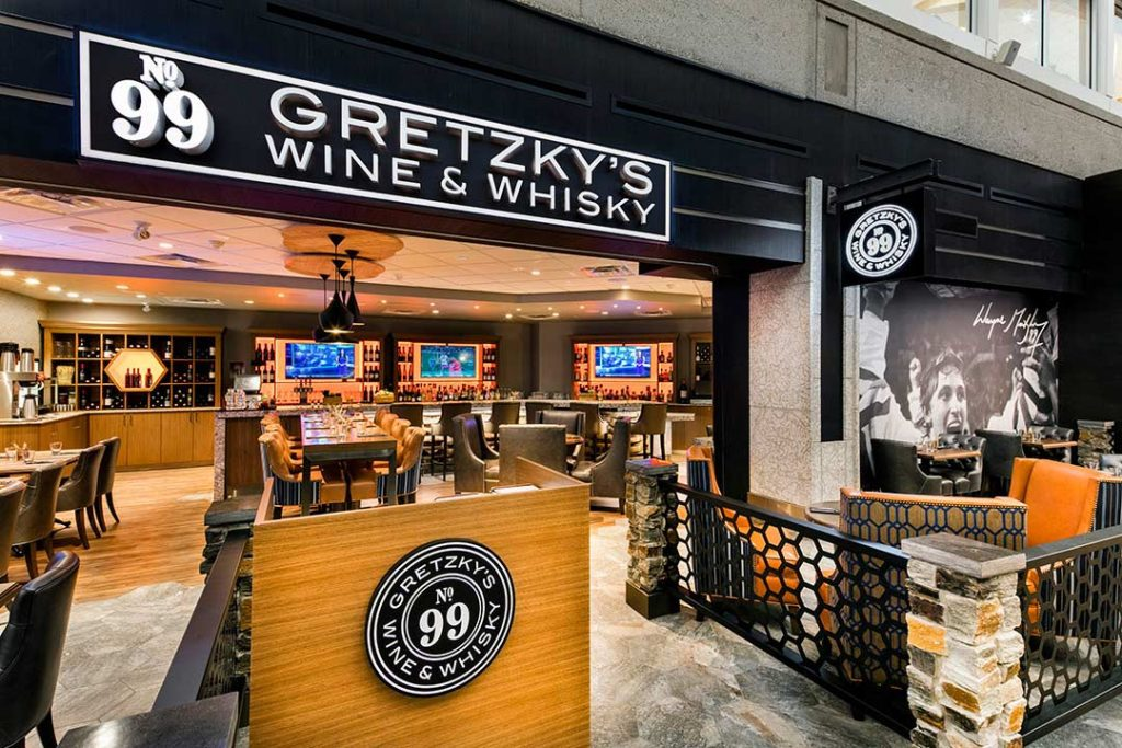 Photograph of Gretzky's Wine & Whisky storefront and lounge interior