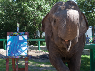 Lucy the elephant stands proudly next to her newly painted picture