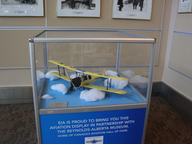 Photograph of a model plane within a display case from the Reynolds-Alberta Museum Home of Canada's Aviation Hall of Fame